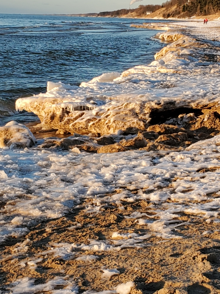 Sand and snow on lakeshore